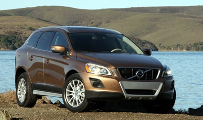 A three-quarter front view of a tan 2010 Volvo XC60