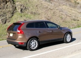 A three-quarter rear view of a tan 2010 Volvo XC60 T6 AWD
