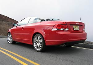 A three-quarter rear view of a red 2006 Volvo C70 T5
