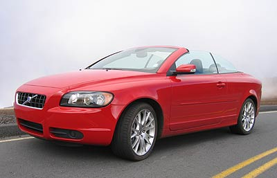 A three-quarter front view of a red 2006 Volvo C70 T5