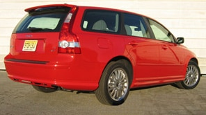 A three-quarter rear view of a red 2006 Volvo V50 T5 AWD