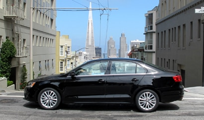 A side view of a black 2011 Volkswagen Jetta in San Francisco, California