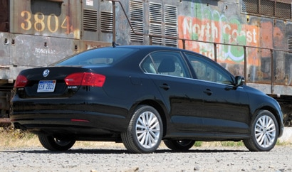 A three-quarter rear view of a black 2011 Volkswagen Jetta SEL