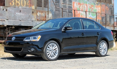 A three-quarter front view of a black 2011 Volkswagen Jetta SEL
