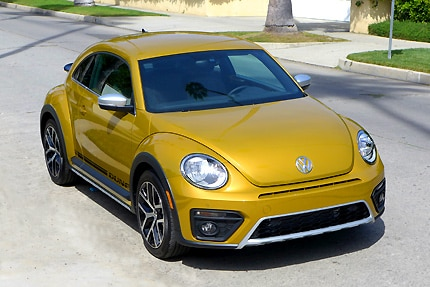 A three-quarter front view of a 2016 Volkswagen Beetle Dune coupe