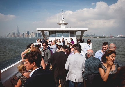 Guests take in the view of the New York City skyline during La Nuit en Rosé