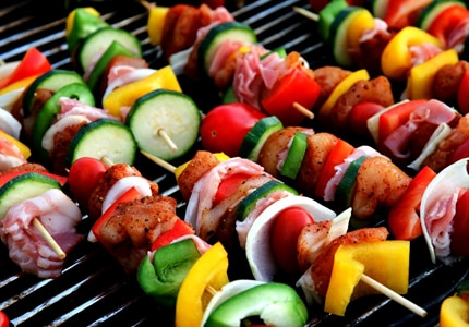 Veggies work great on skewers but you can also grill them in aluminum foil, with oil, to prevent them from falling through the grill gates