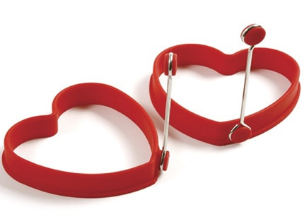 The Norpro Silicone Heart Egg/Pancake Rings both have a knock-down handle for easy removal from the pan