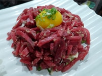 Thinly sliced cut raw Piedmontese beef seasoned with salt, sesame oil and brown sugar mixed with julienned Asian Pear, topped with an egg yolk
