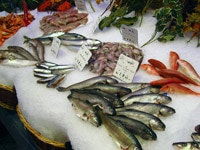 Several types of fish for sale at a market in Paris