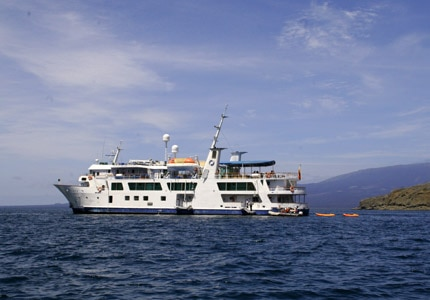 Metropolitan Touring's yacht, Isabela II, sailing away on the Galápagos Cruise