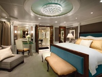 The Owner's Suite bedroom on the Oceania Riviera
