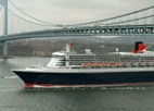 The Queen Mary 2 passes under the Verrazano-Narrows Bridge in New York