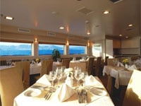 The dining room aboard the M/Y Harmony G