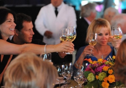 Guests make a toast at the V Foundation Wine Celebration