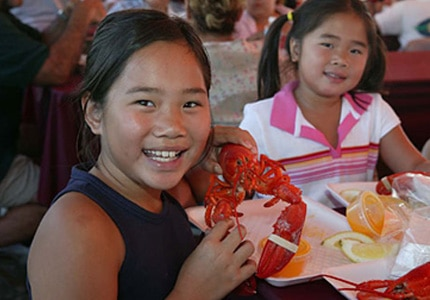 Kids enjoy fresh Maine lobster at the Port of Los Angeles Lobster Fest