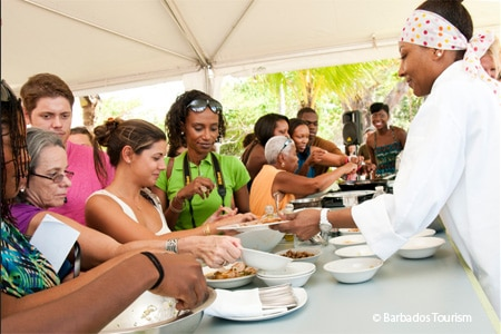 Patrons sample fresh cuisine at the Barbados Food & Wine and Rum Festival