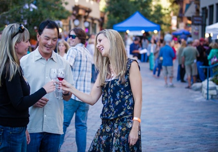 Guests mingle and sip on wine at the Mammoth Wine Weekend in California