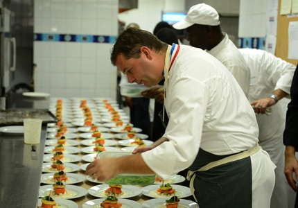One of six celebrated chefs prepares the evenings tastings at the second annual Epicurea event in Anguilla, Caribbean