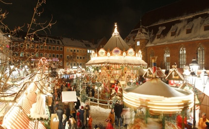 Families enjoy the sights and smells of the holidays at the traditional German Christkindlesmarkt in Nuremberg