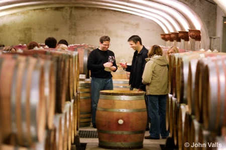 A tasting takes place in a barrel cellar at Wine Country Thanksgiving in Willamette Valley, OR