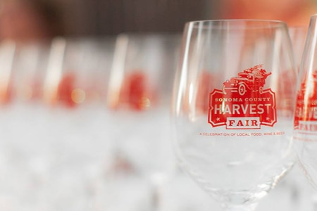 Participants attending the Sonoma County Harvest Fair receive an event-branded wine glass to enjoy tastings