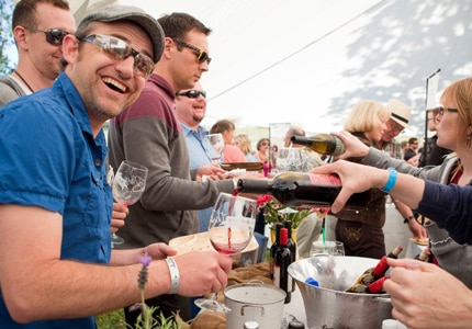 Attendees enjoy wine at the Earth Day Food & Wine Festival