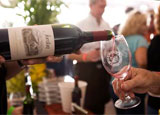 A glass of wine being poured at the Santa Fe Wine & Chile Fiesta in New Mexico