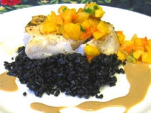 Smoky sea bass with cream ani glace, papaya mango salsa and forbidden black rice