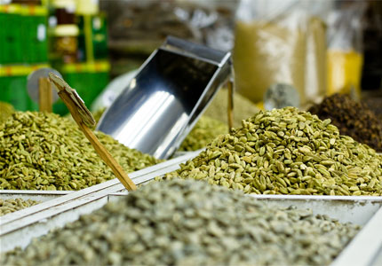 Cardamom for sale at a souq (image by Flickr user Omar Chatriwala)