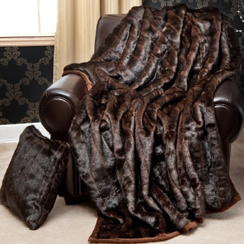Snuggle up beneath this luxurious faux fur throw blanket