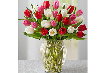 One of GAYOT's Top 10 Romantic Gifts, this colorful bouquet from 1-800-flowers.com features 30 red, pink and white tulips