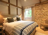 A cottage guest room at Daylesford Organic Farm Gloucestershire in the UK