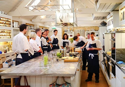A cooking class at Daylesford Organic Farm Gloucestershire in the UK