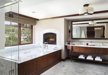 The Ritz-Carlton Suite bathroom, which includes a Jacuzzi bath, at The Ritz-Carlton, Bachelor Gulch