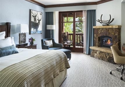 Guest rooms offer amenities such as private balconies with mountain or valley views, in-room fireplaces and plush bedding at The Ritz-Carlton, Bachelor Gulch