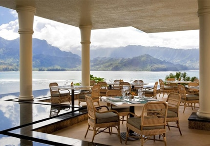 Overlooking Hanalei Bay and Makana Mountain, the Makana Terrace at The St. Regis Princeville Resort offers standard dishes, as well as inventive flavors