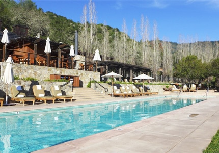 Take a dip in the sparkling swimming pool at Calistoga Ranch, one of GAYOT's Top 10 Romantic Hotels in Napa/Sonoma, CA