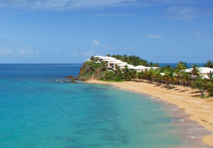Book your next trip to paradise at Curtain Bluff in Antigua, one of GAYOT's Top 10 Caribbean Resorts