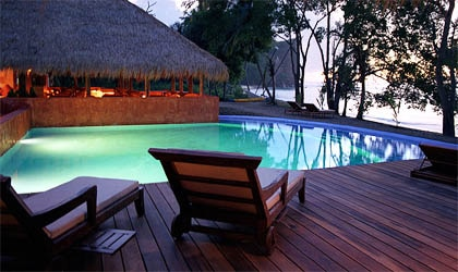 Relax by the tranquil swimming pool at Laluna in Grenada