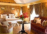 A guest room at Hotel Chateau de Mirambeau in France