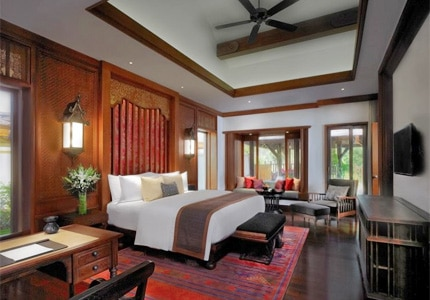 A guest room at Anantara Xishuangbanna Resort & Spa, one of GAYOT's Top 10 Hotels in China