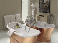 Vintage-style bathtub in a guest bathroom of Coworth Park in Ascot, England