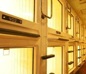 A row of capsules at Capsule Inn Akihabara