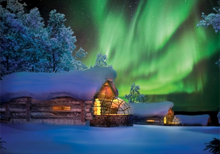 A view of the Northern Lights from Kakslauttanen Arctic Resort in Finland, one of GAYOT's Top 10 Extreme Hotels in the World