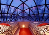 An interior view of a glass igloo at Hotel Kakslauttanen in Lapland, Finland