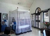 A bedroom inside Taprobane Island's villa