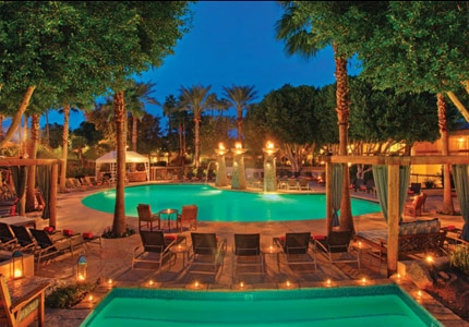 The torch-lit swimming pool and hot tub at FireSky Resort and Spa, one of GAYOT's Top 10 Value Hotels in Phoenix/Scottsdale, Arizona