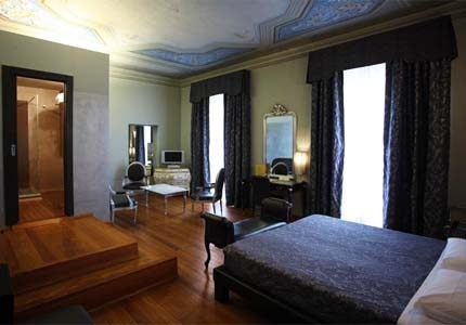 A guest room at Borghese Palace Art Hotel in Florence, Italy