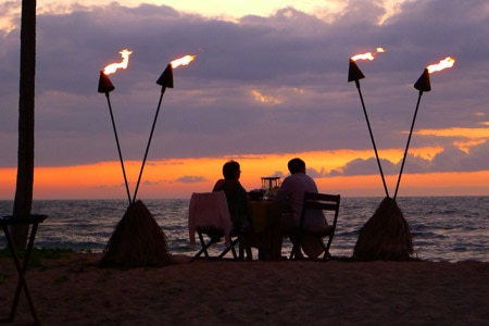 A romantic dinner with an ocean view at Four Seasons Hualalai at Historic Ka'upulehu in Hawaii